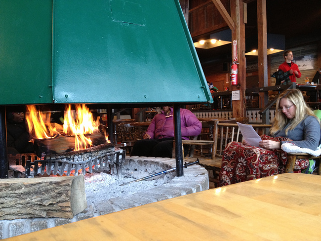 Rustic Daylodge at Snow Trails provides a cozy fireplace atmosphere for reading