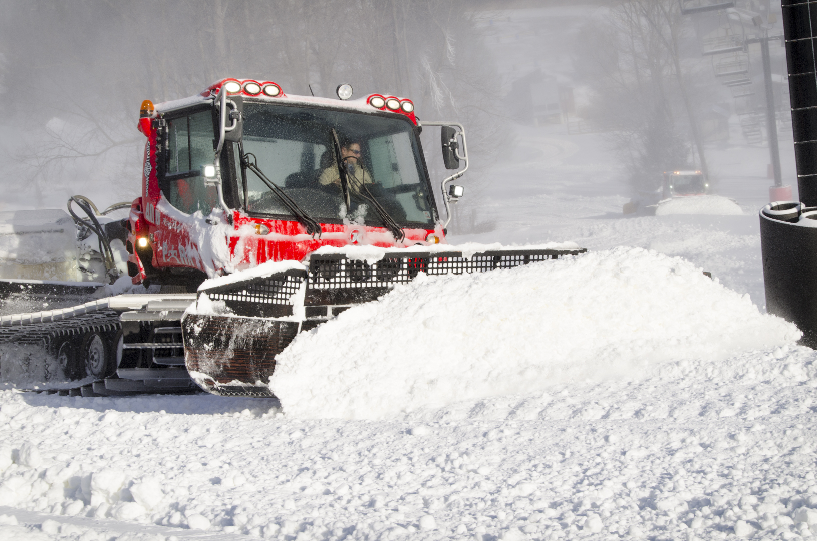 Pisten Bully Snow Cat pushing fresh snow in Mogul Area at Snow Trails
