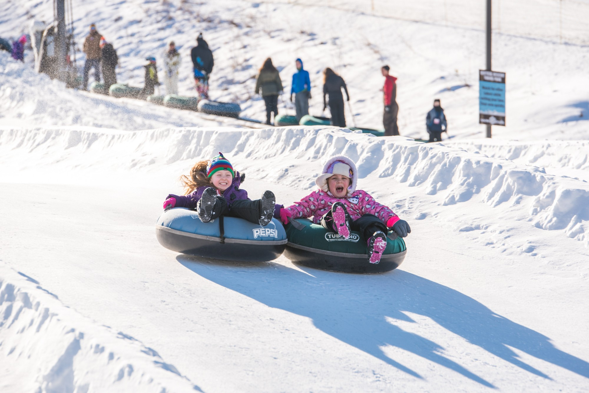 All smiles at Snow Trails Vertical Descent Tubing Park