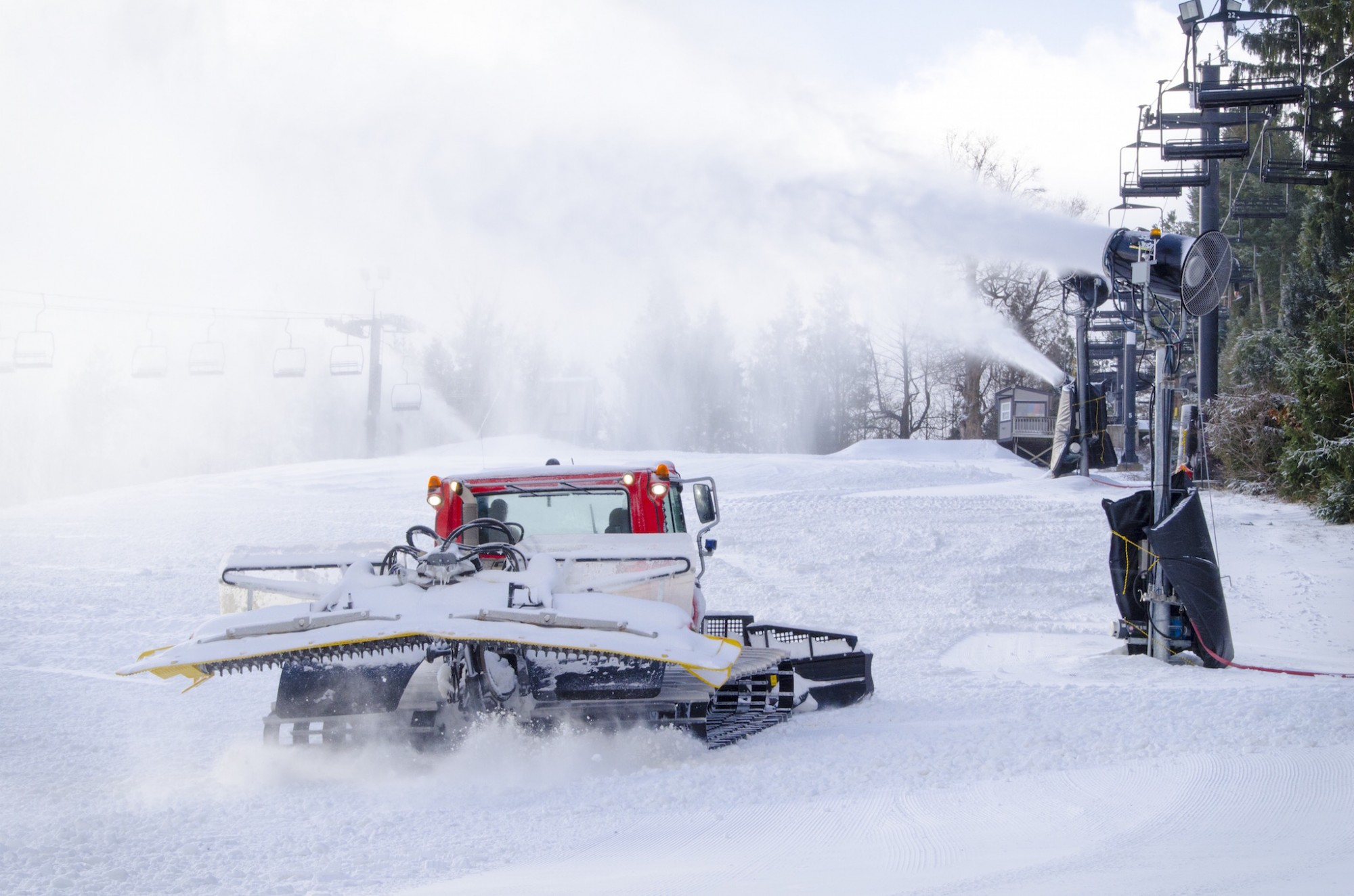 Snow Trails Pisten Bully Snow Cat shaping slopes for Opening Day