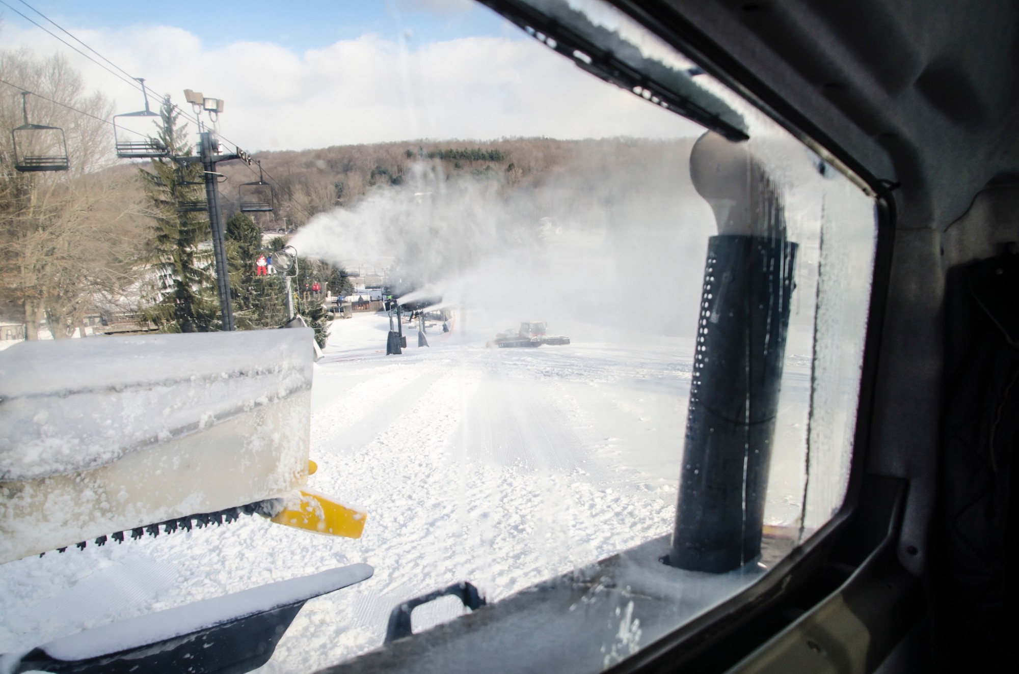 Snow Cat Grooming Machines out on Competition Slope during Snowmaking