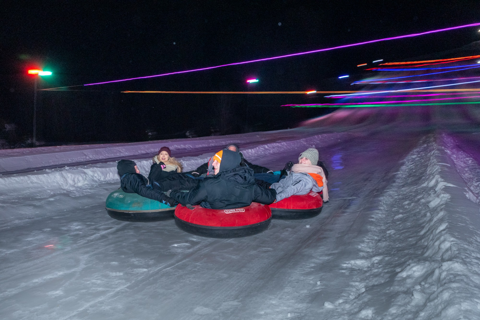 Glow Tubing at Snow Trails with LED String Lights and LED Tower Lights Illuminating Snow Tubing